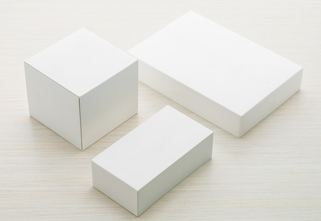 product box: White boxes mock up on wooden background