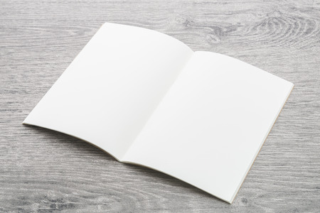 Blank Note book mockup on wood background Imagens - 42231385