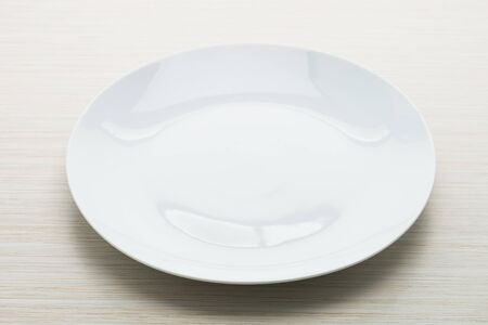 empty: Empty white plate dish on wooden background Stock Photo