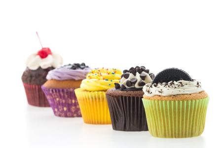 Cupcakes geïsoleerd op wit Stockfoto