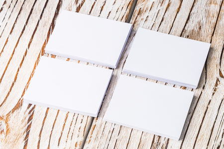 paper board: Blank white paper mock up on white wood background - filter effect Stock Photo