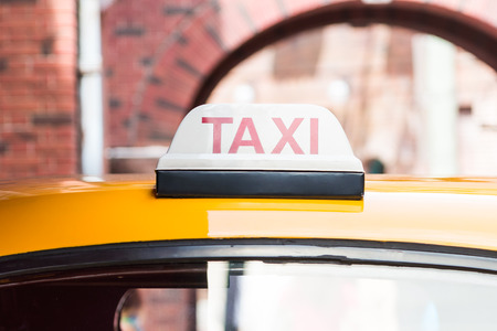 taxi: Taxi sign on roof top car