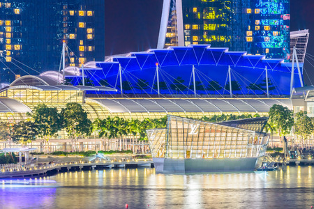 vuitton: SINGAPORE - JULY 17: Cityscape of Singapore, July 17, 2015, Singapore. Louis Vuitton shop on the water at front of Marina bay. Editorial