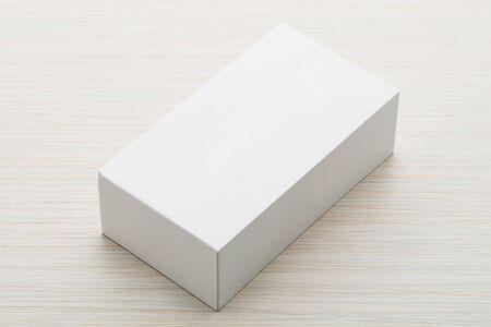 White box mock up on wooden background Imagens
