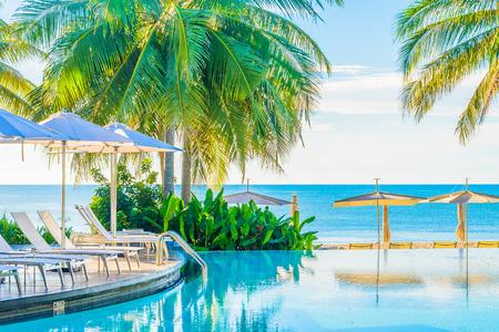 Beautiful luxury hotel pool resort nearly beach - Bright light processing style