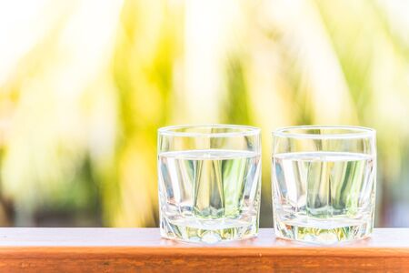 glass of water: Glass water - Sunflare filter processing Stock Photo