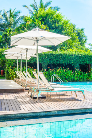 hotel resort: Umbrella with chair in hotel  swimming pool resort
