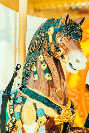 play the old park: Carousel horse in the park - vintage filter effect