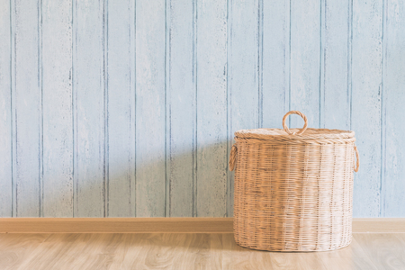 laundry room: Wicker basket in the empty room - light vintage filter effect Stock Photo