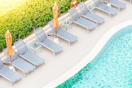 swimming pool: Top view of hotel pool resort with sunflare filter effect