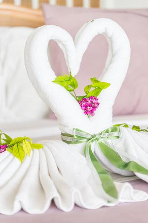 honeymoon suite: Sweet towel decoration on bedroom - Love concept for valentine Stock Photo