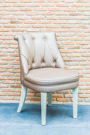 leather chair: Luxury leather chair on brick wall background Stock Photo