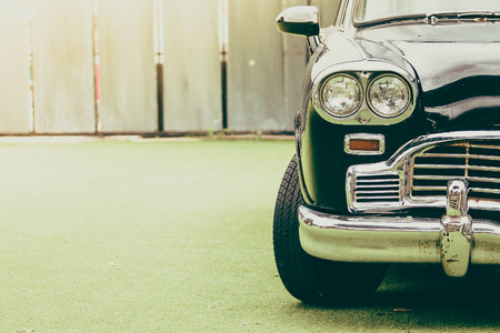 shiny car: Vintage headlight lamp on vintage classic car - vintage filter effect