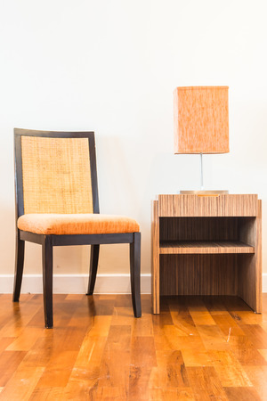 table lamp: Chair and lamp on wood table decoration interior room Stock Photo