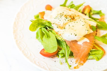 poached: Poached eggs with salmon and rocket salad - Selective focus point