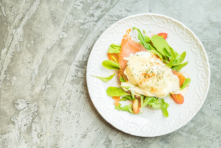 royale: Poached eggs with salmon and rocket salad - Top of view Stock Photo