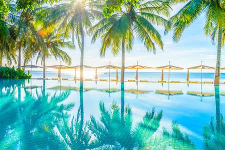 nearly: Beautiful luxury hotel pool nearly beach - Bright light processing style Stock Photo