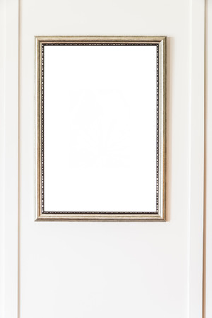 layout design: Blank frame on white wall background