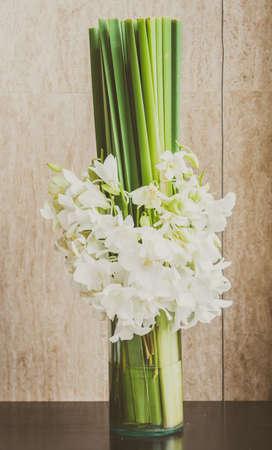 glass vase: Orchid flower in glass vase - vintage filter