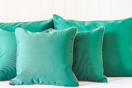 green sofa: Green sofa pillow decoration in living room