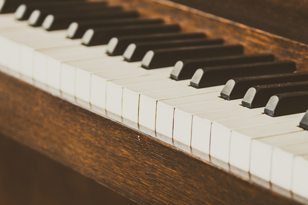 piano closeup: Selective focus point on Old vintage piano keys - vintage filter effect
