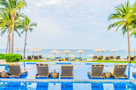 hotel resort: Hotel resort swimming pool with umbrella and chair on the beach