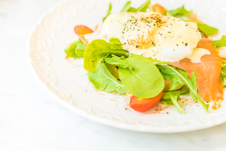 royale: Poached eggs with salmon and rocket salad - Selective focus point