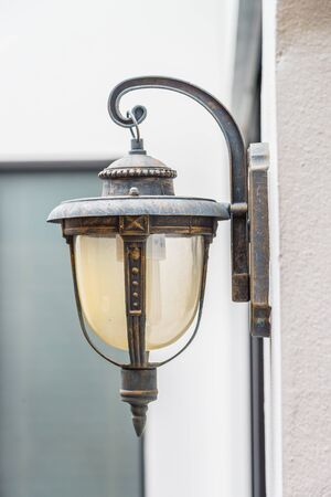 sconce: Vintage light lamp on wall Stock Photo