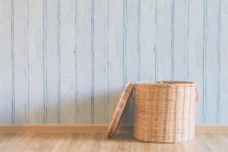 living things: Wicker basket in the empty room - light vintage filter effect Stock Photo