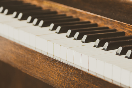 white sheet: Selective focus point on Old vintage piano keys - vintage filter effect