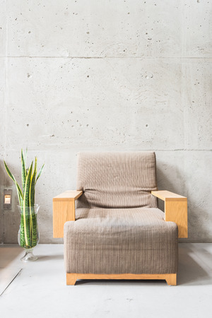 old furniture: Beautiful luxury wooden sofa decoration on empty wall with vase plant Stock Photo