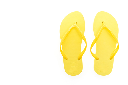 Yellow flip flops isolated on white background Foto de archivo