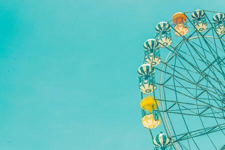 Vintage ferris wheel in the park - vintage filter effect
