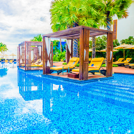 hotel resort: Beautiful Luxury Swimming pool with umbrella and chair in hotel resort Editorial