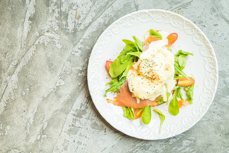 poached: Poached eggs with salmon and rocket salad - Top of view Stock Photo