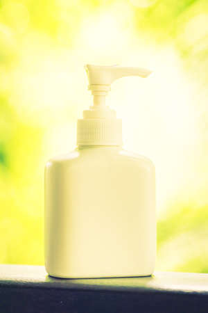lotion bottle: Lotion bottle with outdoor view - vintage filter effect Stock Photo