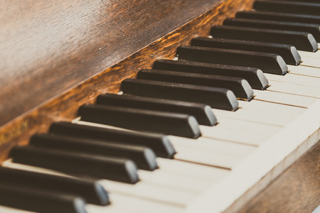 old piano: Selective focus point on Old vintage piano keys - vintage filter effect