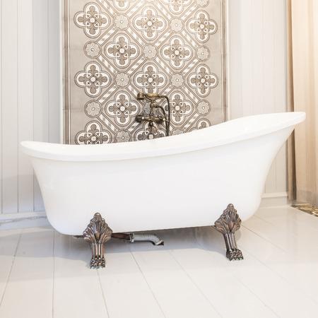 Vintgae Bathtub in toilet room 스톡 콘텐츠