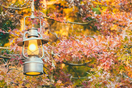 autum: Old lantern with outdoor view in autum season - vintage filter Stock Photo