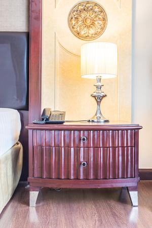 bedside: Light lamp on bedside table decoration bedroom interior