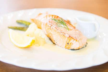 steak: Grilled salmon steak with lemon - selective focus point