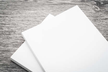 brochure cover: Blank white mock up book on wooden background - filter effect processing