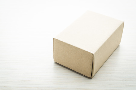 brown box: Brown box mock up on wooden background - filter effect