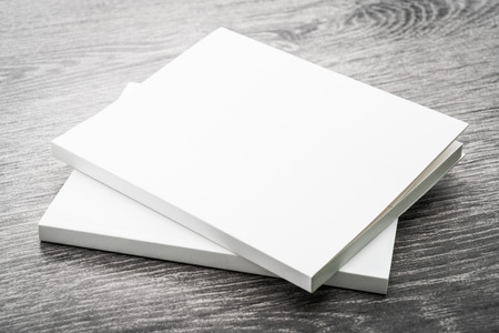 isolated on wooden: Blank white mock up book on wooden background - filter effect processing