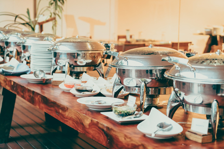 table: Selective focus point on Catering buffet in hotel restaurant - Vintage filter effect Stock Photo
