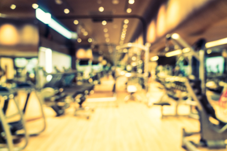 gym room: Abstract blur fitness gym room interior background - Vintage filter
