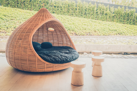 modern chair: Outdoor deck with modern chair and table - Vintage filter