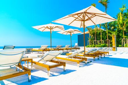 hotel resort: Beautiful luxury hotel swimming pool resort with umbrella and chair Stock Photo