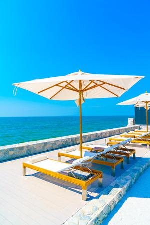 resort: Beautiful luxury hotel swimming pool resort with umbrella and chair Editorial