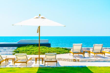 hotel resort: Beautiful luxury hotel swimming pool resort with umbrella and chair Editorial